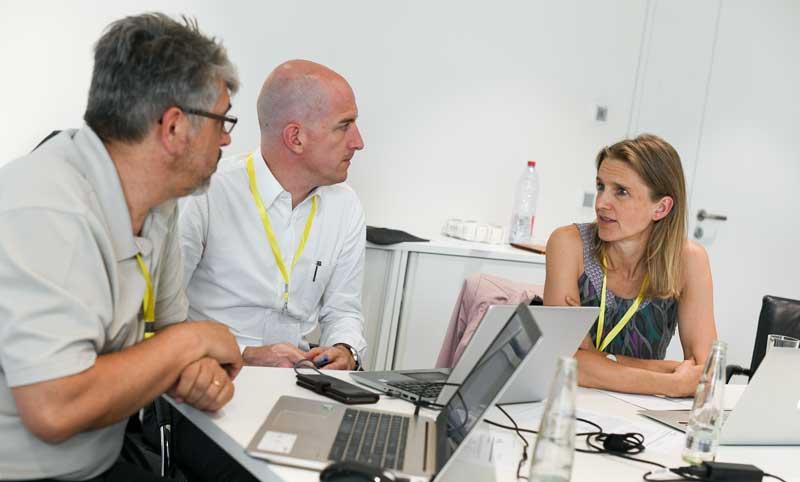 Solar Impulse experts around a table